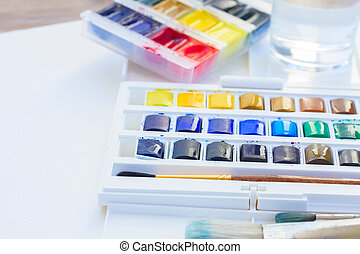 set of watercolor paints with brushes