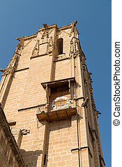 Curch tower - Low angle take of a church tower against blue...