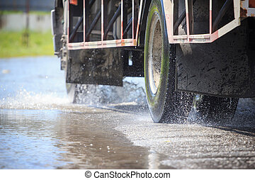 Splash by a truck as it goes through flood water