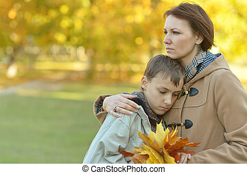mother with son - Beautiful mother with son in autumn park