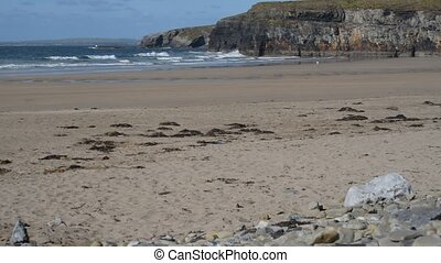 walking the beach and cliffs - lone man walking the beach...