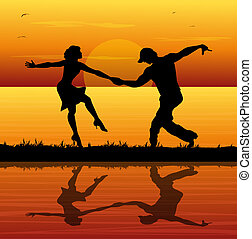 dancers on the beach at sunset - silhouette of dancers on...