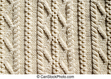 beautiful detail of woven hand made knit woolen design texture and knitting needle. Fabric element white copy space background