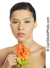 Woman with a flower in spa