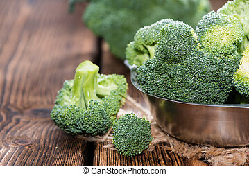 Raw Broccoli detailed close-up shot on wooden background