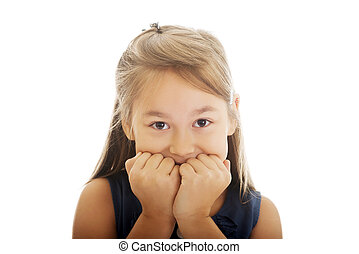 Scared girl biting her nails - Scared little girl biting her...
