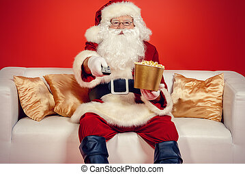 entertainment santas - Traditional Santa Claus sitting on...