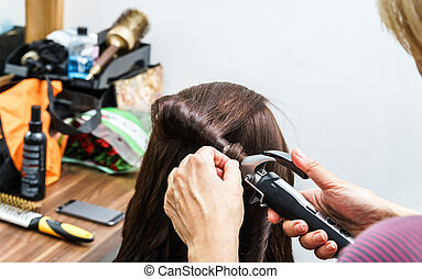 Process of frizzle while hair-dressing before wedding