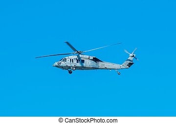 Military Chopper on the Blue Sky. Marine Helicopter in...