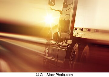 Trucking Business Concept - Semi Truck In Motion Speeding...