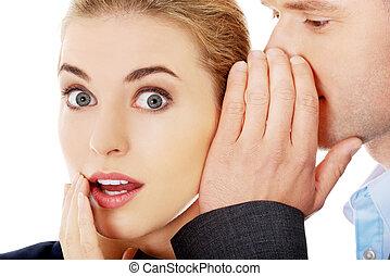 Men whispering secret to his friend - Men whispering secret...