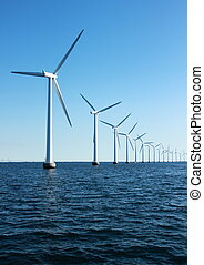 Vertical perspective of ocean windmills with horizon
