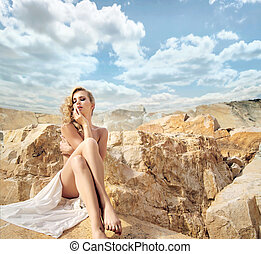 Sensual blonde with the beautiful landscape behind - Sensual...