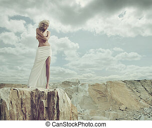 Blond lady standing on the edge of the mountain - Blond...
