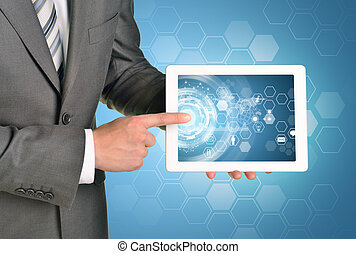 Man hands using tablet pc. Image of business elements on screen