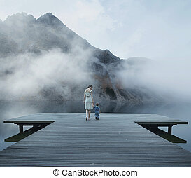Conceptual photo of the mom with child walking on the pier -...