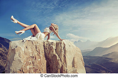 Sensual blonde relaxing on the rock - Sensual blonde...