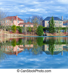 Country houses on rhe pond in Canada