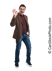 Happy young man gesturing OK sign - Happy young man in shirt...