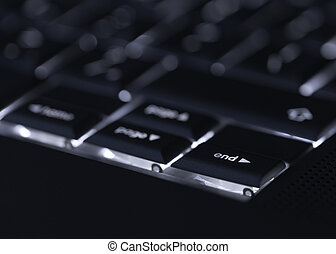 Closeup of backlit computer laptop keyboard selective focus...