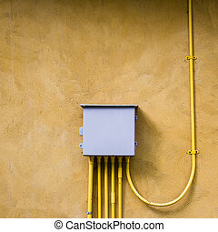 control electrical box on yellow wall background.