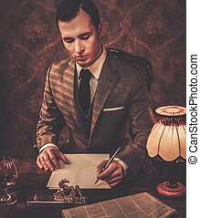 Retro man in grey suit holding a pen