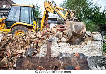 industrial machinery working with debris and dust, loading a...