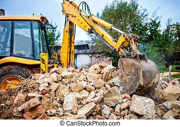 industrial hydraulic excavator on construction and...