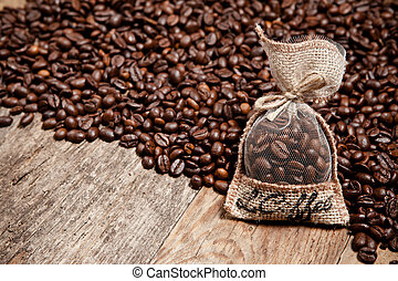 Coffee beans in bag on wooden table - Coffee beans in bag on...
