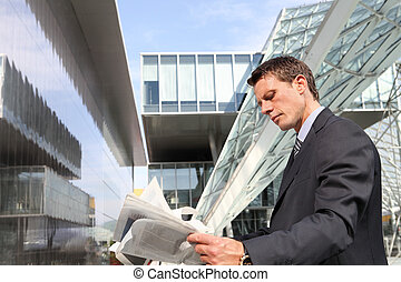 business man reading the financial newspaper
