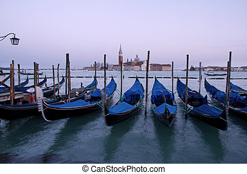 Venice, Italy - Some gondole in front of Saint Giorgio...