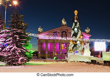 New Year's city - The central square of a city decorated to...