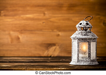 Lantern - Christmas lantern on wooden background