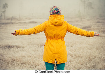Young Woman with raised hands enjoying outdoor Travel...