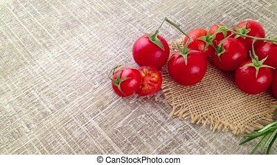 Closeup of bunch of wet tomatoes