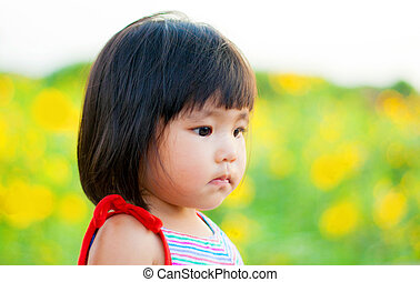 cute asian children on sunflower field