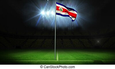 Costa rica national flag waving on flagpole against football...
