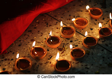 oil lamps on diwali festival - series of oil lamps lit on...