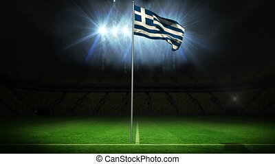 Greece national flag waving on flagpole against football...