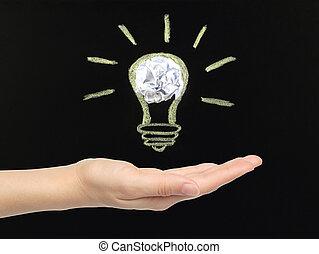 mão, com, Giz, luz, bulbo, com, Amarrotado, papel,