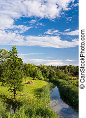 River in rural area - Small river with curves and hayfield...