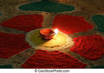 diwali the festival of lights - oil lamp with colorful...