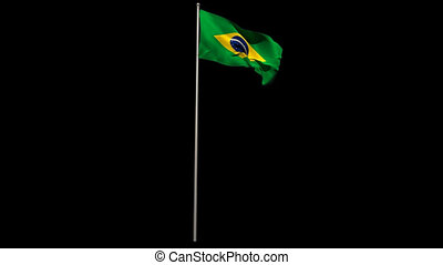 Brasil national flag waving on flagpole on black background