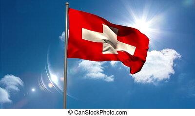 Switzerland national flag waving on flagpole on blue sky...