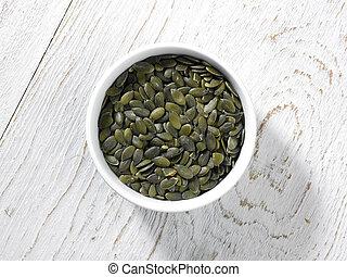 Pumpkin Seeds - seen from above a bowl of Pumpkin Seeds on a...