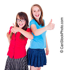 Teen girls standing and showing thumbs up - Happy smiling...