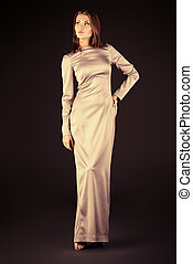 evening dress - Beautiful fashionable model posing at studio...