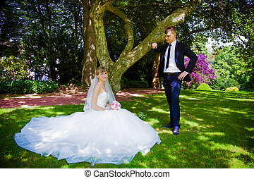 Happy bride and groom in a park