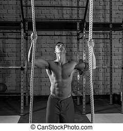 Climb with two 2 ropes exercise man at gym