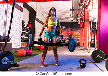 Hex Dead Lift Shrug Bar Deadlifts woman at gym workout...